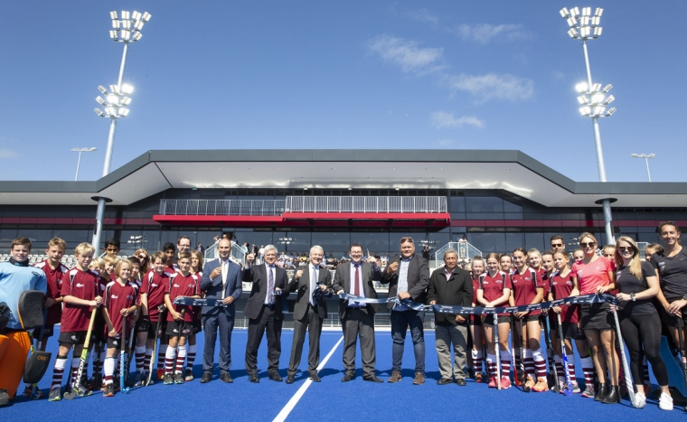 The ribbon is cut for the opening of the new National Hockey Stadium in Albany.
